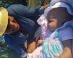 Matthew beach with my god daughter amen